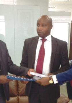 HANDOVER: Emmanuel Kamanzi, the new Managing Director EDCL , CEO Rwanda Energy Group, Jean Bosco Mugiraneza, and outgoing Managing Director EDCL, Robert Nyamvumba at the ceremony held in Kigali last week.