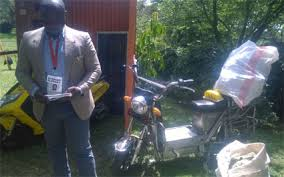 Charles Ogingo, one of the co-founders of Pfoofy and the two motorbikes. EUNICE KILONZO