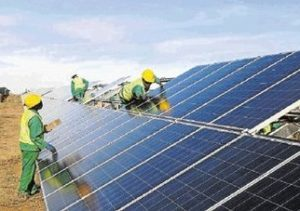 Workers assemble the Kalkbult solar energy plant, the first solar plant to feed into the national grid. Pic credit Sunday Times