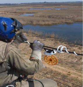 Eskom installing the world-first solar powered nocturnal bird anti-collision device. Pic credit: Eskom