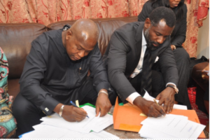 The Benin minister of energy, Spero, and the CEO of Genesis, Akinwole Omoboriowo II, signing the  PPA at a meeting in London this week