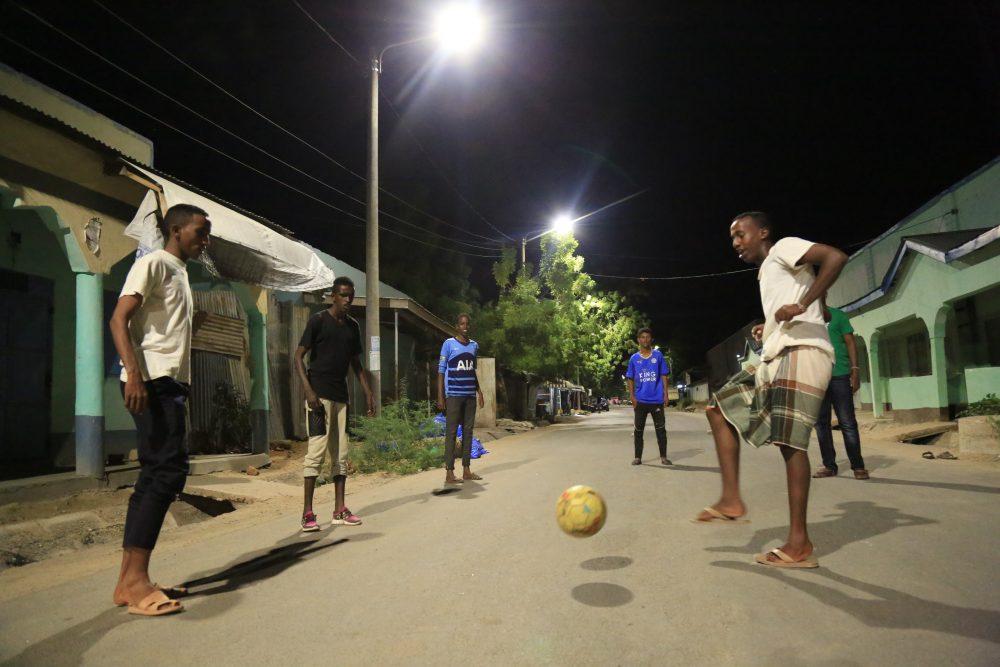 Night football: Young men playing football in Garissa town. Pic credit: Kenya Power