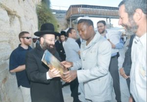 TOGO PRESIDENT Faure Gnassingbe receives a book from Rabbi Shmuel Rabinowitz during a visit to the Western Wall yesterday.. (photo credit:WESTERN WALL HERITAGE FOUNDATION)